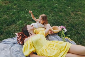 Laughing woman in yellow dress lie o