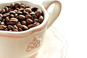 coffee beans in a white cup and sauc