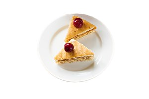 Sponge cake with cherries on a plate