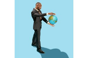 Businessman holding the world in the