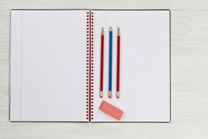 Notepad with pencils and eraser