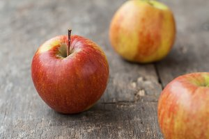 red apples on wooden rustic backgrou