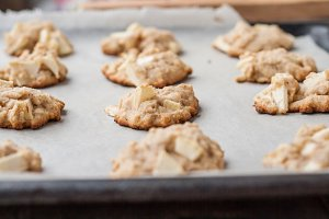 Cookies with a apples on baking tray