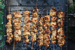 Meat-kebab on skewers and grill grat