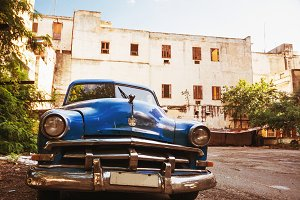 old blue american car parked in old