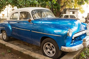Blue old and classical car parked of
