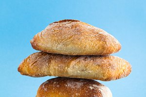 a pile of fresh Italian bread on blu
