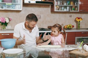 Little kid girl help man to cook Chr