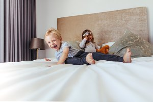 Happy kids playing in bedroom