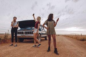 Women with broken down car