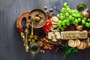 Wooden serving board with vegan snac