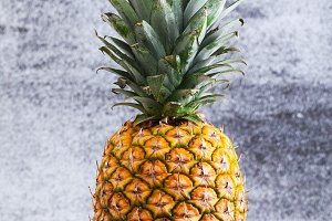 A whole ripe pineapple on a table on