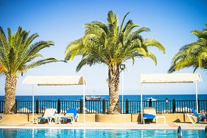 Tropical hotel beach palms pool and