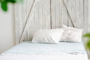 A small cozy bed with white linen
