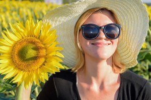 Girl on the field of sunflowers