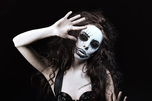 Woman in image of gothic freak clown