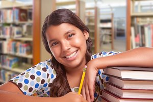 Happy Hispanic Girl Student with Pen