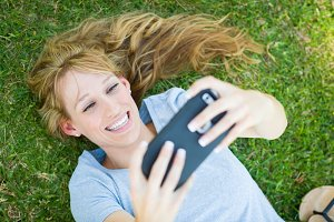 Young Adult Woman Laying in Grass Ta