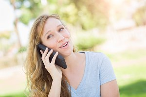 Young Adult Woman Outdoors Talking o