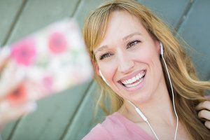 Young Adult Woman Wearing Earphones