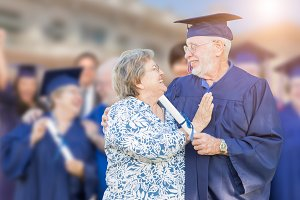 Senior Adult Male In Cap and Gown Be