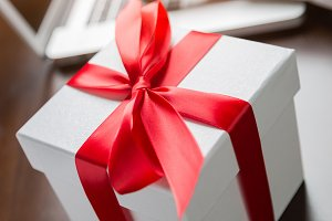 White Gift Box with Red Ribbon and B