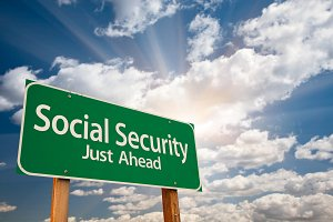 Social Security Green Road Sign Over