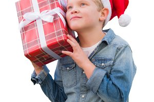 Young Boy Wearing Santa Hat Holding