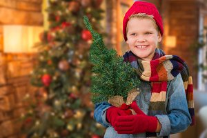 Boy Wearing Scarf In Christmas Decor