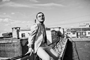 Dreamer stylish macho man in gray su