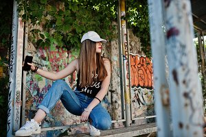 Stylish casual hipster girl in cap a