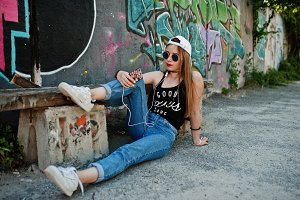 Stylish casual hipster girl in cap,
