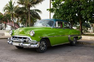 Old green American car parked in Cie