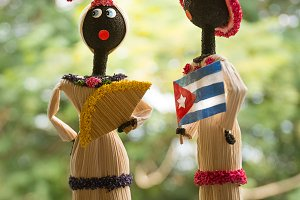 Cuban craft puppets, she with fan an