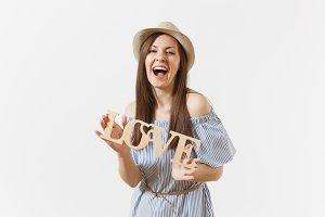 Happy woman in blue dress, hat holdi