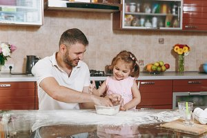 Little kid girl helps man to cook Ch