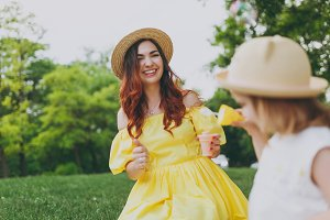 Laughing woman in yellow clothes pla