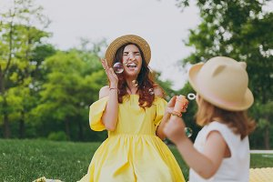 Overjoyed woman in yellow clothes pl