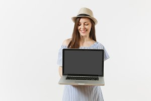 Young woman holding modern laptop pc
