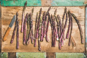 Fresh purple asparagus and knife