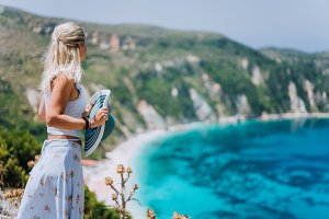 Young woman in front of Petani beach