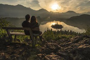 Young Couple on Bench at Sunrise