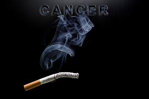 Burning cigarette, smoke and text ca