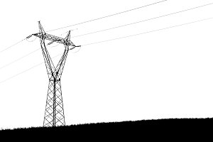 Silhoutette of Pylon on green hill