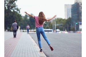 Rear view of a happy woman walking