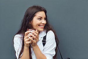 A brunette girl with a coffee mug at