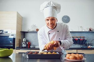 A confectioner prepares cupcakes in
