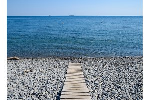 Wooden path to the sea. Flooring of