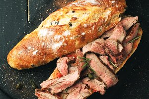 Sandwich with roast beef and spices