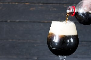 A pour of dark beer. A glass of dark